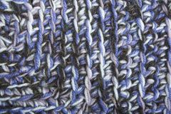 Blue, white and black knit texture wool threads Royalty Free Stock Image