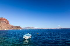 Blue and white boat on the Aegean sea. Therasia island, Greece Royalty Free Stock Photography
