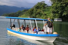 The blue and white boat charters tourists across the lake. stock photography