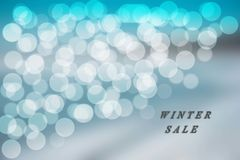 Blue and white bokeh background on the blue winter sale Stock Photo