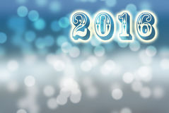 Blue and white bokeh 2016 New Year greeting card Stock Images