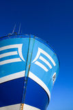 Blue and white bow of a trawler on a blue sky Stock Image