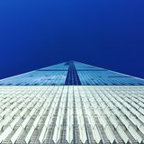 Blue and White Building Under Blue Sky during Daytime in Low Angle Photography Royalty Free Stock Photo