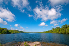 Blue and White in Canoe Country. Summer Day on Winchell Lake in the Boundary Waters royalty free stock photo