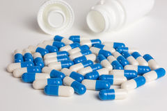 Blue and white capsules Royalty Free Stock Images