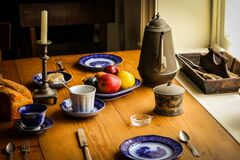 Blue and White Ceramic Plate Next to Apple Fruit and Brown Tea Pot Royalty Free Stock Photos