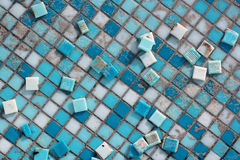Blue and white ceramic tiles in abandoned swimming pool. Royalty Free Stock Photo