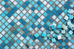 Blue and white ceramic tiles in abandoned swimming pool. Stock Images