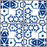 Blue and white ceramic tiles. Patchwork style Stock Photography