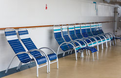 Blue and White Chairs on Deck of Ship Stock Photo