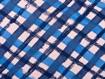 Blue and white chequered cloth background Royalty Free Stock Photo