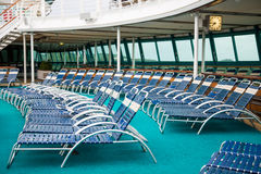 Blue and White Chiase Lounges on Cruise Ship. Rows of blue and white chaise lounges on cruise ship Royalty Free Stock Photography