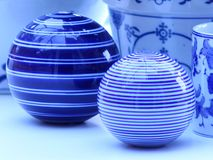 Blue and white striped china. Blue and white china macro image on white background in landscape format stock photos