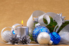 Blue and white christmas balls with silver candle Stock Images