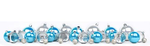 Blue and white christmas baubles lined up 3D rendering. Blue and white christmas baubles lined up on white background 3D rendering Royalty Free Stock Photography