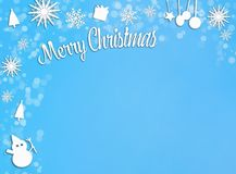 Blue and white christmas decoration paper cut out frame on blue Royalty Free Stock Photo