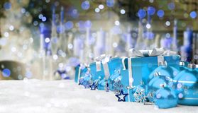 Blue and white christmas gifts and baubles 3D rendering. Blue and white christmas gifts and baubles lined up on snowy background 3D rendering Royalty Free Stock Photos