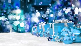 Blue and white christmas gifts and baubles 3D rendering. Blue and white christmas gifts and baubles lined up on snowy background 3D rendering Stock Photos