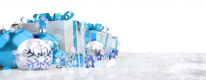 Blue and white christmas gifts and baubles 3D rendering. Blue and white christmas gifts and baubles lined up on snowy background 3D rendering Stock Images
