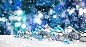 Blue and white christmas gifts and baubles 3D rendering. Blue and white christmas gifts and baubles lined up on snowy background 3D rendering Royalty Free Stock Photography