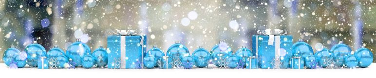 Blue and white christmas gifts and baubles 3D rendering. Blue and white christmas gifts and baubles lined up on snowy background 3D rendering Royalty Free Stock Image