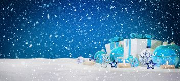Blue and white christmas gifts and baubles on snow 3D rendering. Blue and white christmas gifts and baubles on snowy background 3D rendering Stock Image