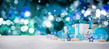 Blue and white christmas gifts and baubles on snow 3D rendering. Blue and white christmas gifts and baubles on snowy background 3D rendering Royalty Free Stock Images