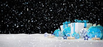 Blue and white christmas gifts and baubles on snow 3D rendering. Blue and white christmas gifts and baubles on snowy background 3D rendering Stock Photos