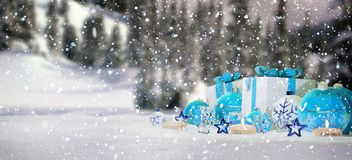 Blue and white christmas gifts and baubles on snow 3D rendering. Blue and white christmas gifts and baubles on snowy background 3D rendering Stock Photo