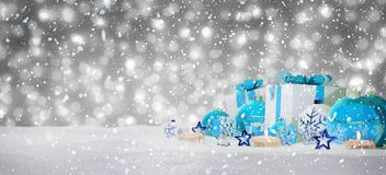 Blue and white christmas gifts and baubles on snow 3D rendering. Blue and white christmas gifts and baubles on snowy background 3D rendering Royalty Free Stock Photo