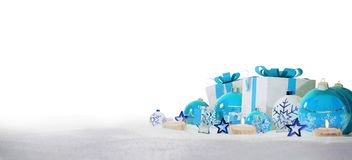 Blue and white christmas gifts and baubles on snow 3D rendering. Blue and white christmas gifts and baubles on snowy background 3D rendering Stock Images