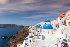 Blue and white church of Oia village Royalty Free Stock Photo