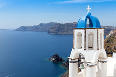 Blue and white church of Oia village  Stock Photos