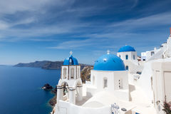 Blue and white church of Oia village Royalty Free Stock Photography