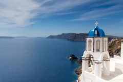 Blue and white church of Oia village Royalty Free Stock Images