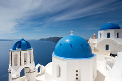 Blue and white church of Oia village  Royalty Free Stock Image