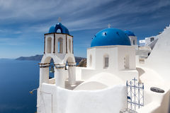 Blue and white church of Oia village Stock Photography