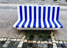 Blue and white city stone bench Royalty Free Stock Photography