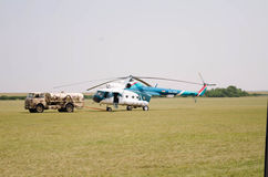 Blue-white civil helicopter on the airfield Royalty Free Stock Photos