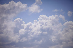Blue and white clouds close-up. Blue and white cumulus clouds close-up and blue sky Royalty Free Stock Photos