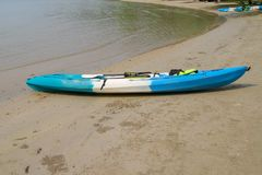 Blue and white color Canoe on the beach at thailand. Kayak malawi lake beautiful africa travel water nature landscape ocean background sky holiday kayaking boat royalty free stock photos