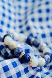 Blue and white color tone lucky fortune stone bracelet include which Lapis lazuli, Sodalite, Howlite and Moonstone on blue white b. Ackground. Amulet accessories Royalty Free Stock Photos