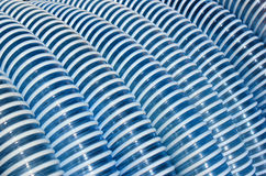 Blue and white corrugated plastic hose as background.  Stock Photo