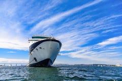 Blue and White Cruise Ship on Horizon Royalty Free Stock Images