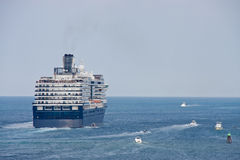 Blue and White Cruise Ship Putting out to sea Royalty Free Stock Photo