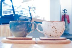 Blue and white cups nearby royalty free stock images