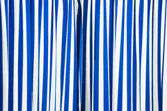 Blue and white curtain Stock Image