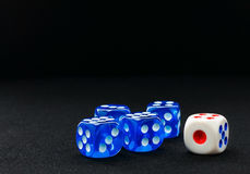 Blue and white dices on the black velvet surface royalty free stock photos