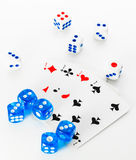 Blue and white dices and cards on white background stock photos
