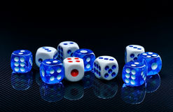 Blue and white dices on the glossy black background. Few blue and white dices on the glossy black background stock images